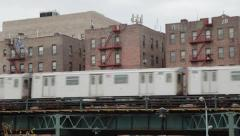New York City subway train and Bronx apartment building Stock Footage