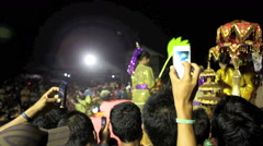 People in audience film a cultural dance performance with their mobile phones Stock Footage