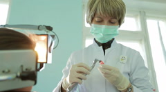 Orthodontist Filing Braces For Crooked Teeth With Special Equipment Stock Footage