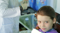 Dentist Fixing Staples In Girl Mouth Stock Footage