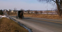 An Amish horse cart travels along a road in rural Pennsylvania. Stock Footage