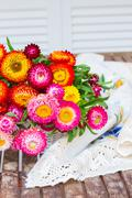 Bouquet of Everlasting flowers on table - stock photo