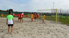 Soccer football kids playing game in the sand ,kids enjoy in sport Stock Footage
