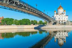 famous temple of christ the savior and the bridge - stock photo