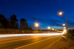 traces of moving cars lights on highway - stock photo
