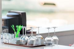 clean dishes on the bar in a summer cafe - stock photo