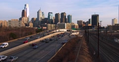 Traffic on a freeway heads into Philadelphia, PA at dusk. Stock Footage