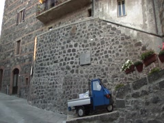 Italian small medioeval town with a typical Ape - stock footage