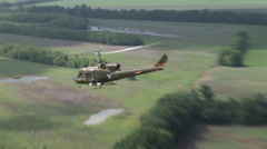 Huey Gunship helicopter flies on a mission Stock Footage