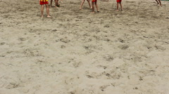 Legs soccer football kids playing game in the sand ,kids enjoy in sport Stock Footage
