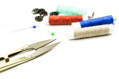 Sewing accessories on white background Stock Photos