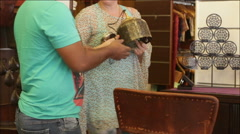 woman chooses decorative accessories in the store - stock footage