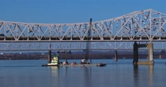 Bridges span the Ohio River near Louisville, Kentucky. Stock Footage