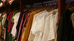 clothes lying on the shelves in the store - stock footage