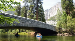 Time Lapse of River Rafting under the Bridge in Yosemite Valley Stock Footage