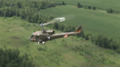Huey helicopter gunship flies over America Stock Footage