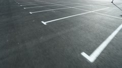 Movement in an empty parking lot shot on steadicam Stock Footage