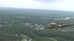 Huey gunship travels on a mission - stock footage
