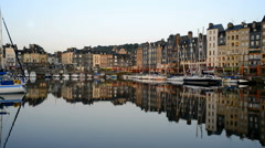 Honfleur harbour in Normandy, France. Color houses and their reflection in water - stock footage