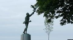 Wide shot of Falconer statue in seaside park  4k Stock Footage
