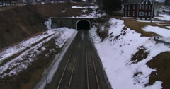 High angle over a freight train going through a tunnel. Stock Footage