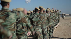 Kurdish Peshmerga training in Northern Iraq marching away from camera - stock footage
