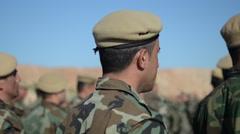 Kurdish Peshmerga training in Northern Iraq marching through frame Stock Footage