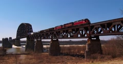 Freight train moves across a tall steel bridge. Stock Footage