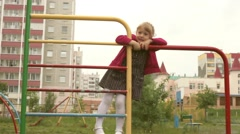 Toddler playing on playground Stock Footage