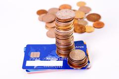 bank card and metal coins - stock photo