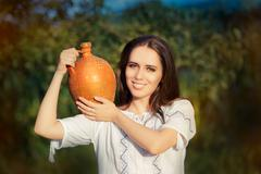 Young Woman with Clay Pitcher Stock Photos
