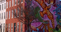 Buildings are painted with beautiful art in a Baltimore slum. - stock footage