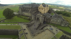 Flying over castle in Stirling, Scotland on a summer day Stock Footage