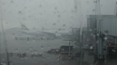Stock Video Footage of Delayed flight due to weather. Hurricane, fog and flood in the airport.