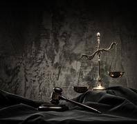 Scales and wooden hammer on judge's mantle Stock Photos