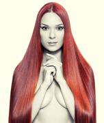 nude woman with long red hair - stock photo