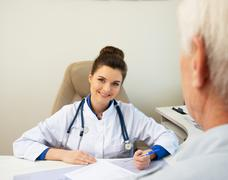 Senior man at doctors's office appointment Stock Photos