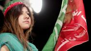 Stock Video Footage of Young woman with PTI Flag at Azadi March Protest in Karachi, Pakistan