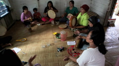 Group of women singing and playing drums during practice - stock footage
