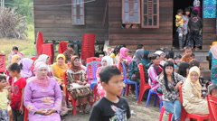 Muslim community gathering in small village Stock Footage