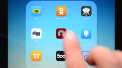 Compilation of social networking apps on iPad display - stock footage