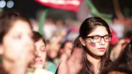 Stock Video Footage of Party Flags over young Women at PTI Azadi March Protest in Karachi, Pakistan