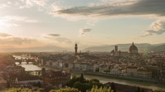 Cityscape of Florence across the river with clouds moving and sun setting. Stock Footage
