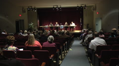 audience and panelists wide shot interior - stock footage