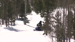 Two snowmobiles pass through frame- two shots Stock Footage