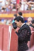 Bullfighter with montera starting rite of praying before bullfight, spain Stock Photos