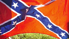 Shaking out confederate rebel flag slow motion Stock Footage