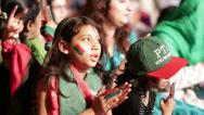 "Stock Video Footage of Young girls sing for a ""New Pakistan"" at PTI Azadi March Protest"