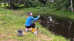 Gir angler fishing in rural pond, hungry cat wait for fish. Stock Footage