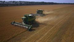 Stock Video Footage aerial view combines harvesting 6 Stock Footage